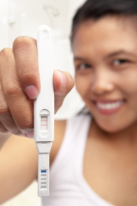 Woman with positive pregnancy test