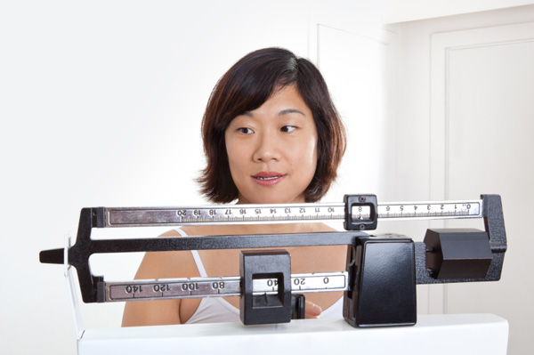 woman on dcotor's scale