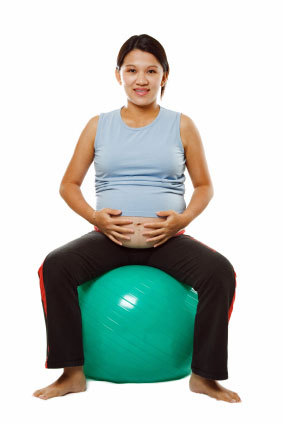 pregnant woman exercise fitness physio ball