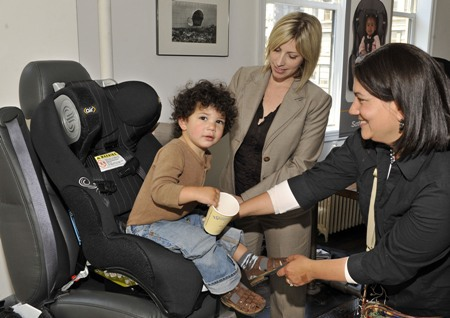 Jennifer Huebner of AAA's Traffic Safety Programs discusses proper car seat installation with mom Esti Berkowitz, right, and her 2-year old son, center, at the Dorel Juvenile Group car seat safety event in New York earlier this month. DOREL/Ray Stubblebine. (PRNewsFoto/Dorel Juvenile Group, Ray Stubblebine)