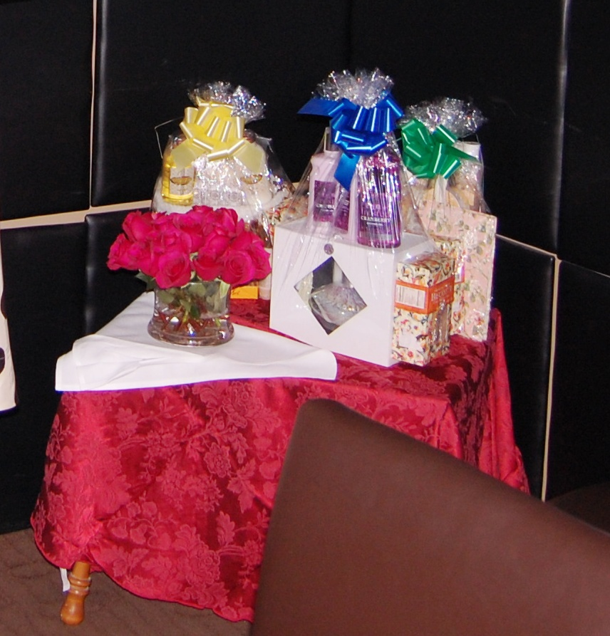 A small raffle table in the corner of the event.